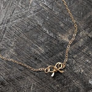3/$30 Tiny bow gold filled chain necklace 17""